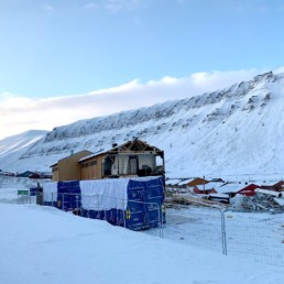 Building partly demolished in Longyearbyen.